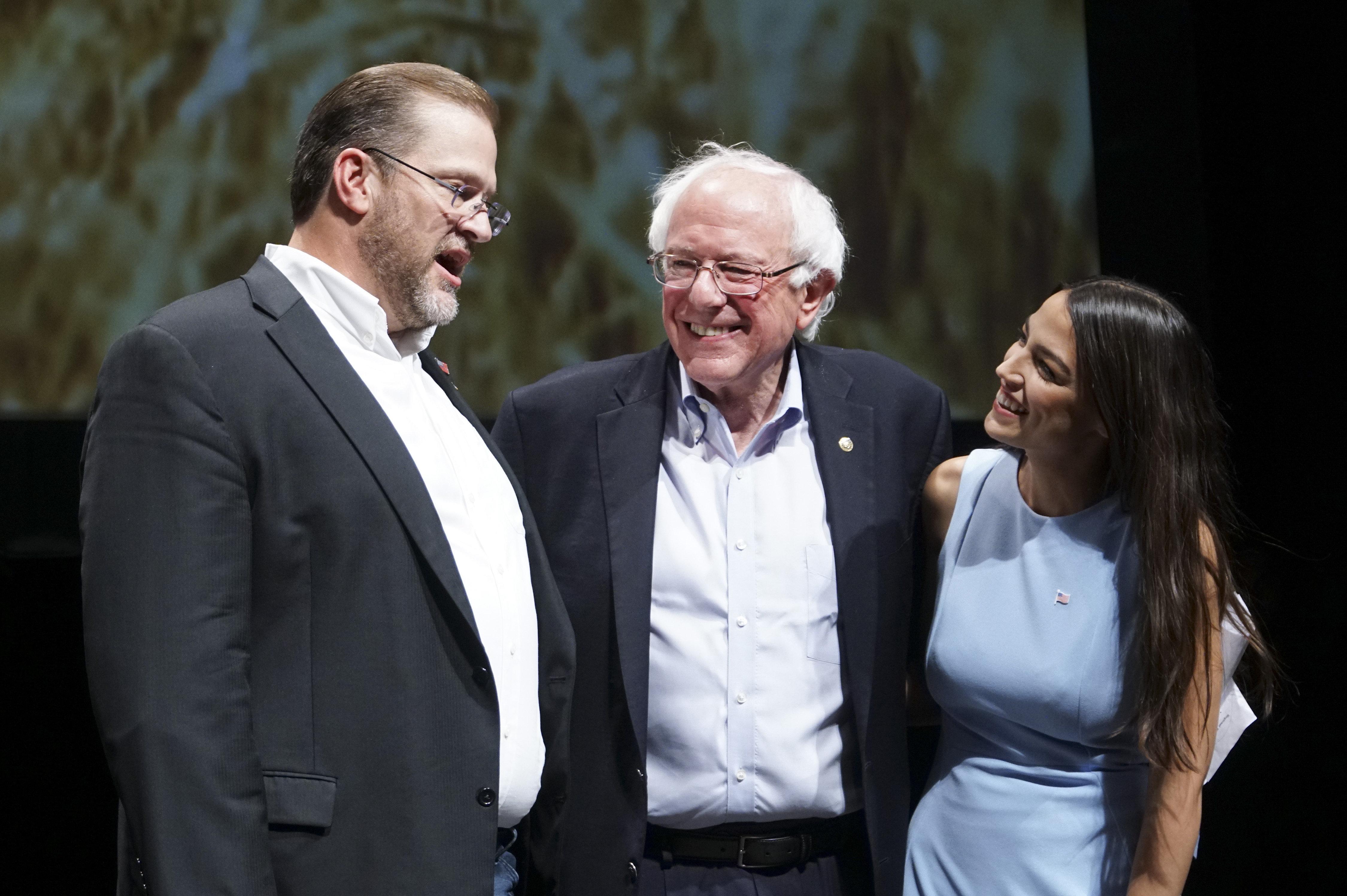 Kansas congressional candidate James Thompson with Sen. Bernie Sanders (I-Vt.) and Alexandria Ocasio-Cortez, a Democratic con