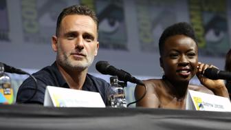 SAN DIEGO, CA - JULY 20:  (L-R) Andrew Lincoln, Danai Gurira and Norman Reedus attend 'The Walking Dead' panel with AMC during during Comic-Con International 2018 at San Diego Convention Center on July 20, 2018 in San Diego, California.  (Photo by Jesse Grant/Getty Images for AMC)