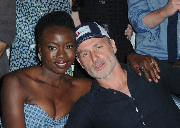 Danai Gurira and Andrew Lincoln hugging it out at