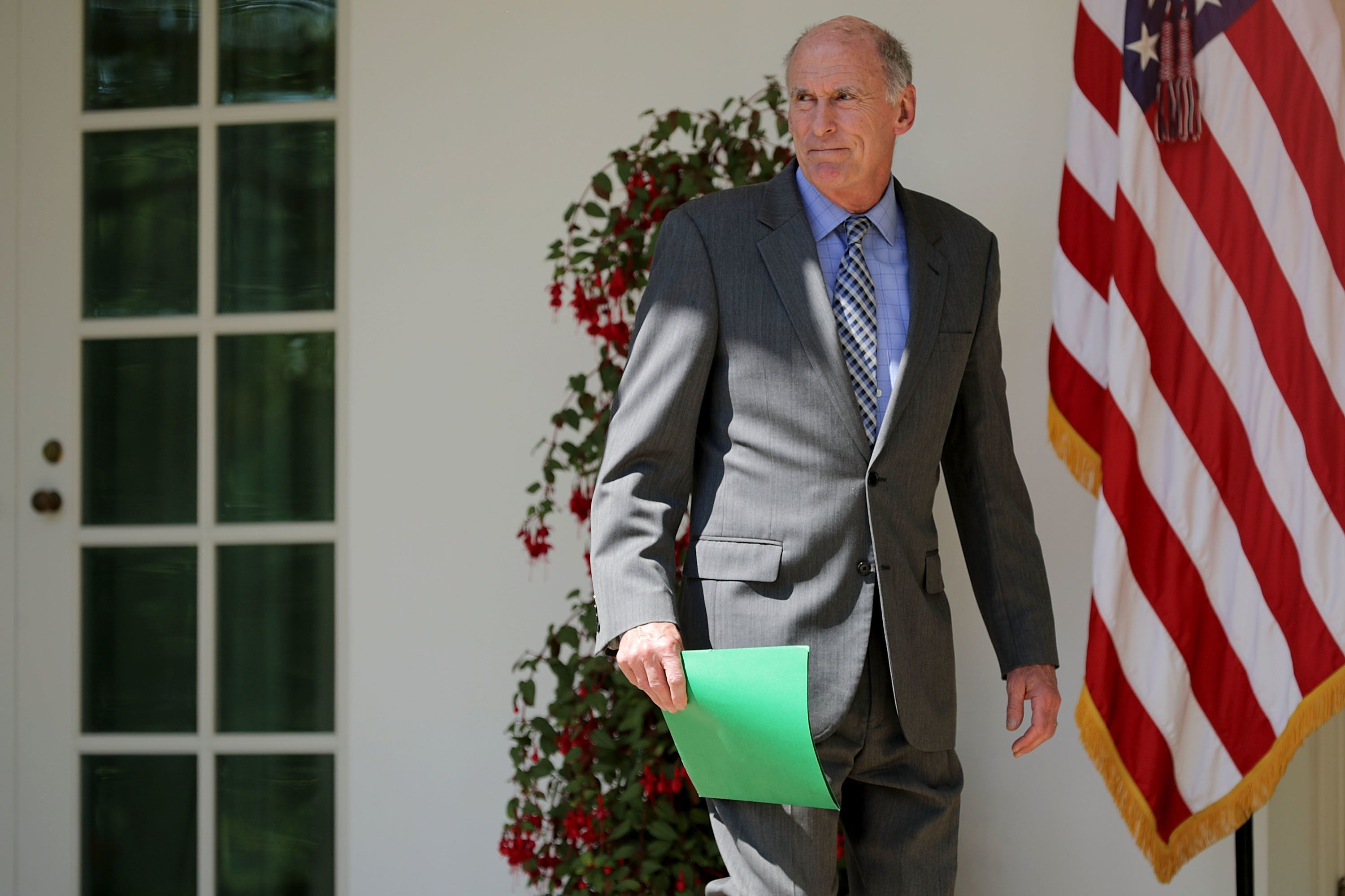 WASHINGTON, DC - MAY 03:  U.S. Director of National Intelligence Dan Coats walks along the Rose Garden Colonnade before an event to mark the National Day of Prayer at the White House May 3, 2018 in Washington, DC. The White House invited leaders from varios faiths and religions to participate in the day of prayer, which was designated in 1952 by the United States Congress to ask people 'to turn to God in prayer and meditation.'  (Photo by Chip Somodevilla/Getty Images)