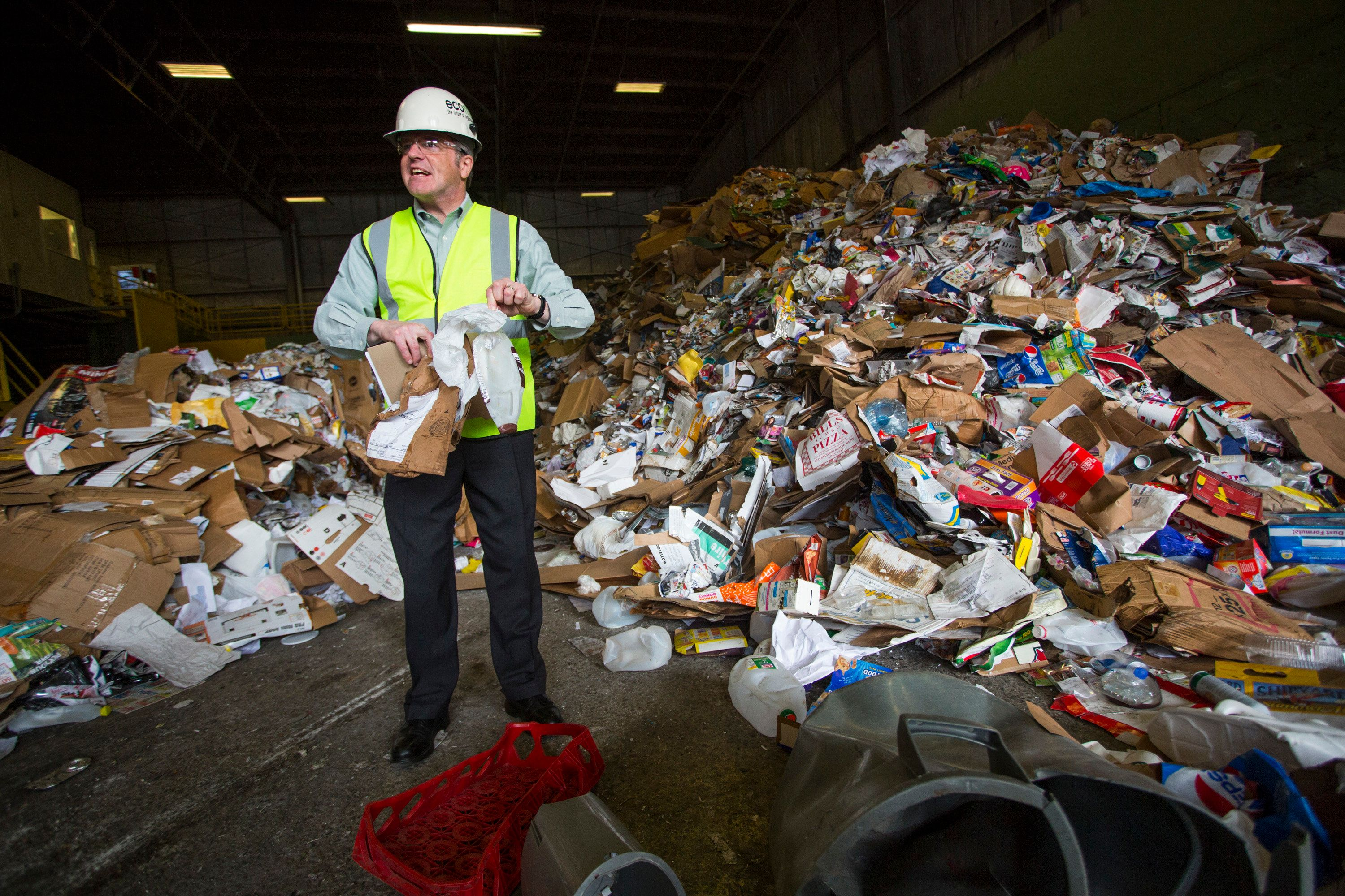 PORTLAND, ME - MAY 3: Ecomaine implements new policies to eliminate contaminated recycling from the waste stream and try to reduce its losses in the global recycled commodity market. Ecomaine CEO Kevin Roche picks through unsorted materials after it was delivered to the facility in Portland on Thursday, May 3, 2018. (Photo by Derek Davis/Portland Press Herald via Getty Images)