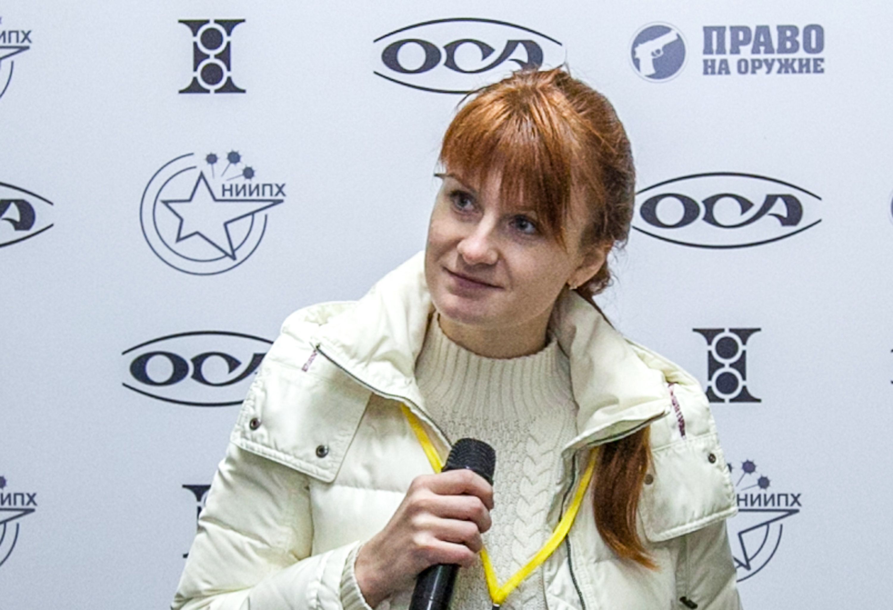Mariia Butina, leader of a pro-gun organization, speaks on October 8, 2013 during a press conference in Moscow. - A 29-year-old Russian woman has been arrested for conspiring to influence US politics by cultivating ties with political groups including the National Rifle Association, the powerful gun rights lobby. Mariia Butina, whose name is sometimes spelled Maria, was arrested in Washington on July 15, 2018 and appeared in court on July 16, the Justice Department said. (Photo by STR / AFP)        (Photo credit should read STR/AFP/Getty Images)