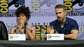 SAN DIEGO, CA - JULY 21:  Zazie Beetz (L) and Ryan Reynolds speak onstage at the 'Deadpool 2' panel during Comic-Con International 2018 at San Diego Convention Center on July 21, 2018 in San Diego, California.  (Photo by Kevin Winter/Getty Images)