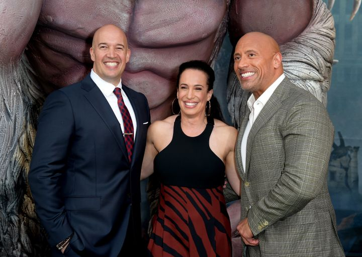 "Hiram Garcia, Dany Garcia and Dwayne Johnson at ""Rampage"" premiere."