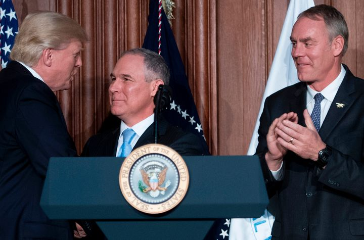President Donald Trump shakes hands with Scott Pruitt before signing an executive order at the EPA's Washington, D.