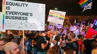 Participants attend a demonstration in Tel Aviv on July 22, 2018, to protest a new surrogacy law that does not include gay couples. - The demonstration comes after parliament, earlier in the week, approved surrogacy for single women or those unable to bear children -- without granting the same right to same-sex couples or single men. (Photo by JACK GUEZ / AFP)        (Photo credit should read JACK GUEZ/AFP/Getty Images)
