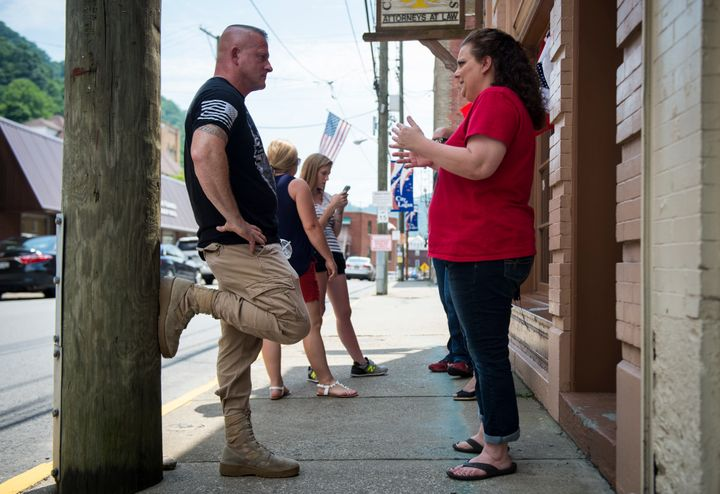 Richard Ojeda speaks with campaign volunteer Heather Ritter, 39, outside his campaign headquarters in Logan, West Virginia, J