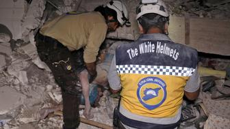 EDITORS NOTE: Graphic content / Syrian rescuers, known as White Helmets, recover bodies in Zardana, in the mostly rebel-held northern Syrian Idlib province, following air strikes in the area late on June 7, 2018. - Air strikes in northwestern Syria, thought to have been carried out by regime ally Russia, killed 38 civilians including four children, a Britain-based monitor said. The raids, which hit a residential zone in the area of Zardana in the northwestern province of Idlib, also wounded 50 people, the Syrian Observatory for Human Rights monitoring group said. (Photo by OMAR HAJ KADOUR / AFP)        (Photo credit should read OMAR HAJ KADOUR/AFP/Getty Images)