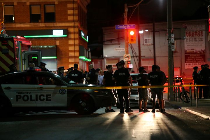 Police are seen near the scene of a mass shooting in Toronto, Canada, on Sunday.
