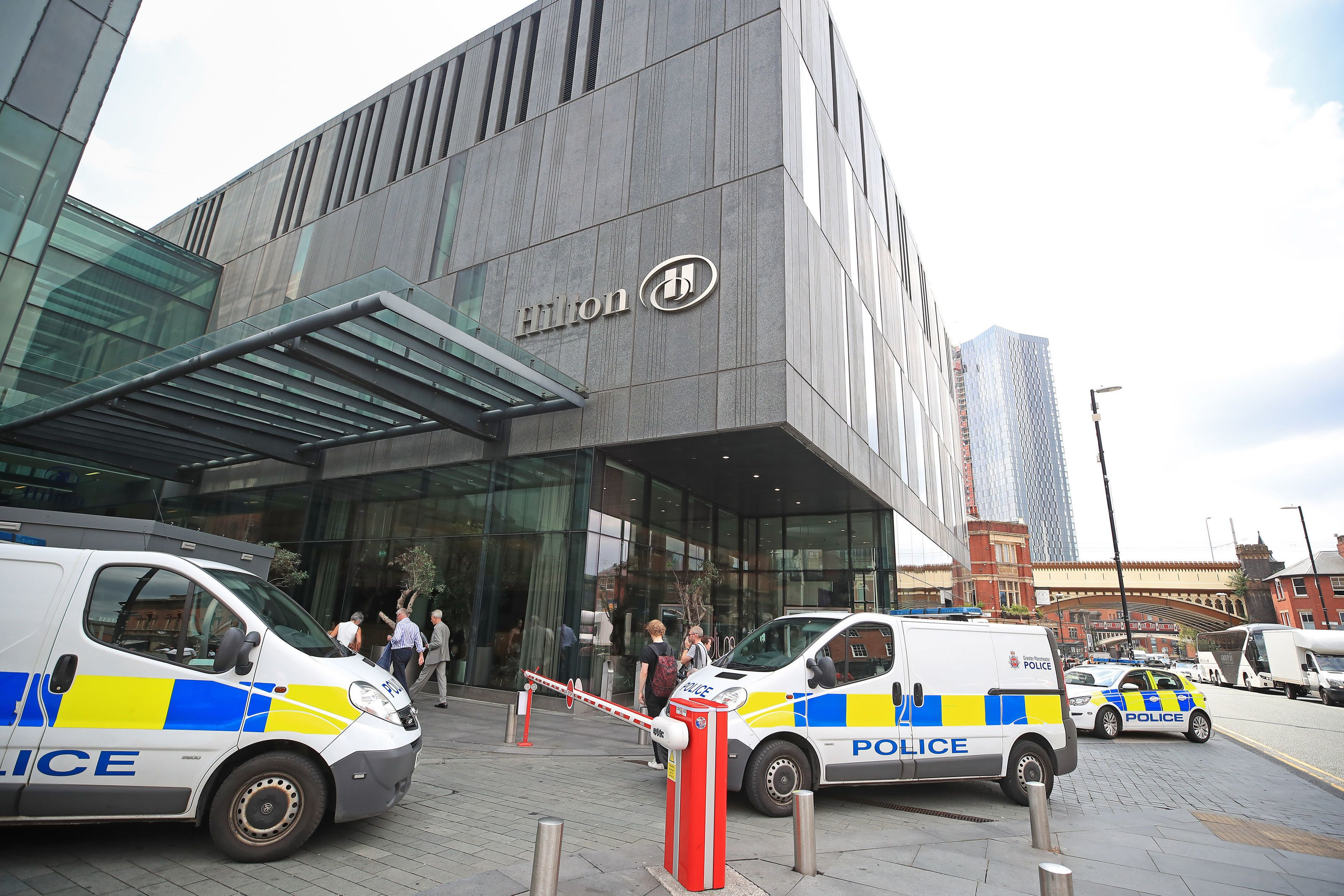 Police at the scene at the Hilton Hotel, Deansgate, Manchester where a woman with serious injuries to...