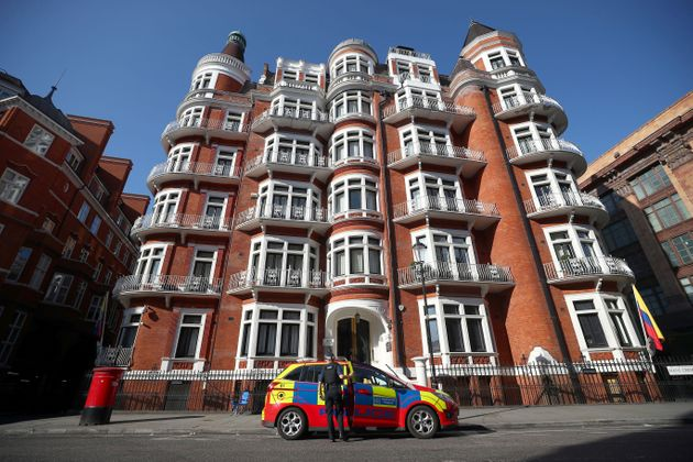 A police officer parks their car outside the Ecuadorian embassy in July where Julian Assange was...