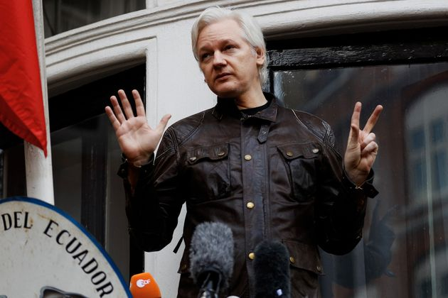 WikiLeaks founder Julian Assange is seen on the balcony of the Ecuadorian Embassy in London, Britain,...