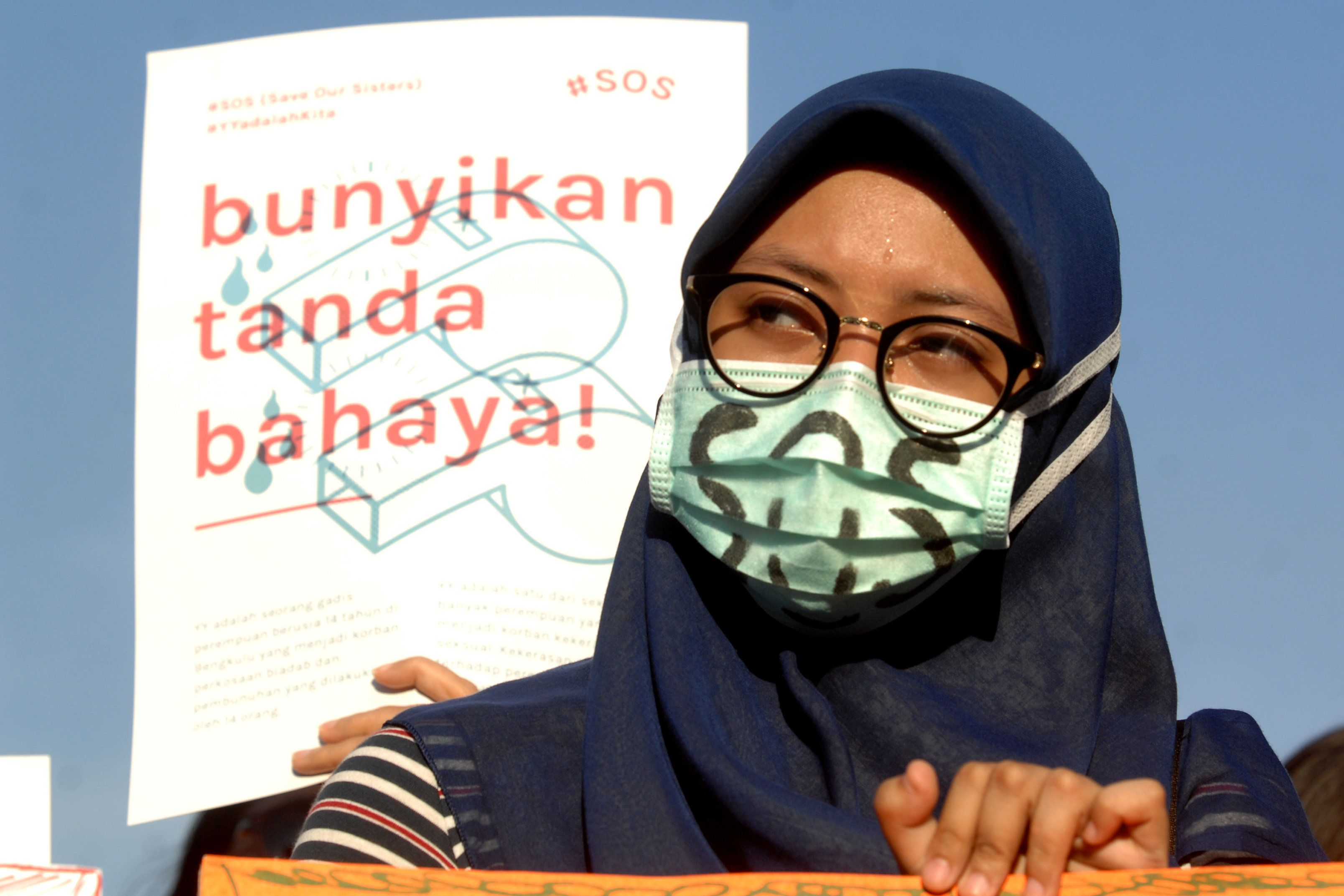 """Women Action Committee during the protest against the sexual violence in Indonesia, with the slogan """"SOS"""", Save Our Sisters, in Jakarta, Indonesia, on May 4, 2016.  (Photo by Dasril Roszandi/NurPhoto via Getty Images)"""
