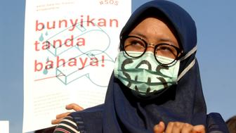 "Women Action Committee during the protest against the sexual violence in Indonesia, with the slogan ""SOS"", Save Our Sisters, in Jakarta, Indonesia, on May 4, 2016.  (Photo by Dasril Roszandi/NurPhoto via Getty Images)"