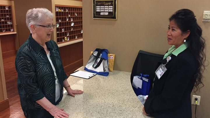 <p>Kathleen Henry talks with a staffer at Greenspring retirement community in Springfield, Virginia. Henry leads voter registration at the precinct. </p>