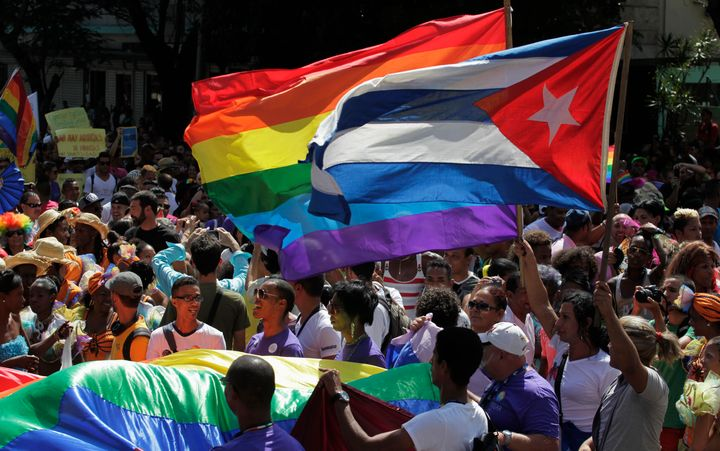 People take part in a gay pride parade in Havana, Cuba, on May 10, 2014.