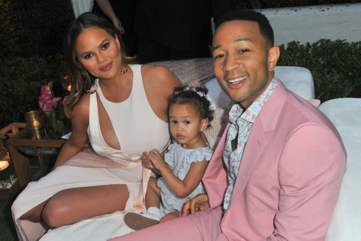 Chrissy Teigen — pictured with John Legend and their daughter, Luna — is having a stressful flight.