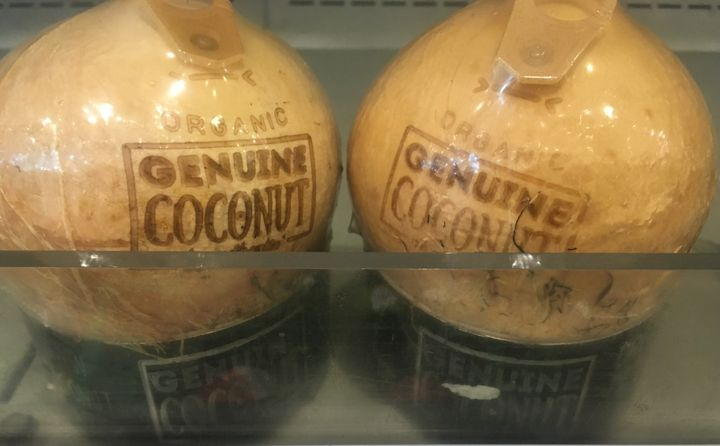 The new generation of shrink-wrapped coconuts have plastic stands and plastic tabs.