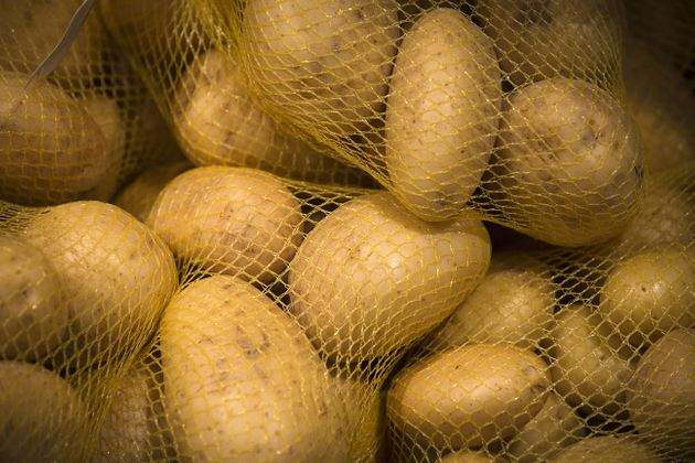 This picture taken on May 9, 2014 shows patatoes on a supermarket display in Paris, France. AFP PHOTO...