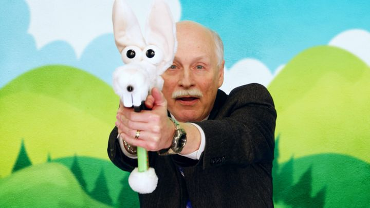 Gun rights advocate Philip Van Cleave participating in an fictional ad campaign for stuffed animal guns for children in the p