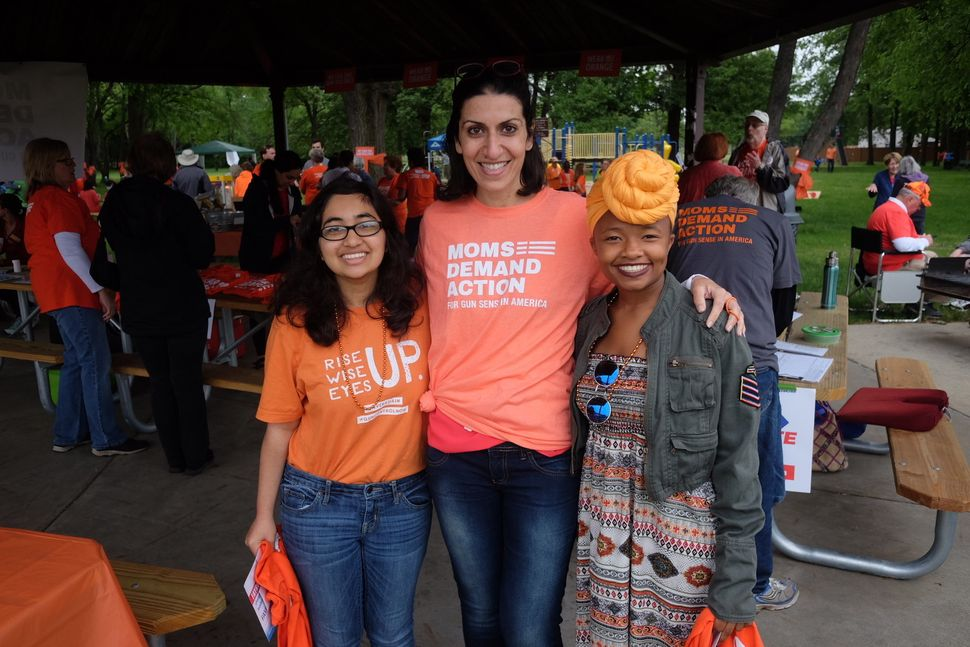 Fayrouz Saad stands a Moms Demand Action rally in Michigan in June 2018.