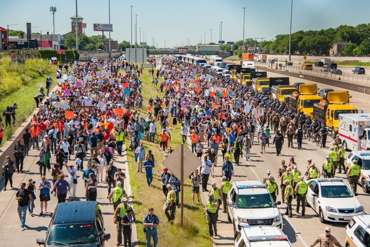 Thousands of activists shut down the Dan Ryan Expressway led by Rev. Michael Pfleger from St. Sabina Catholic Church in Chica