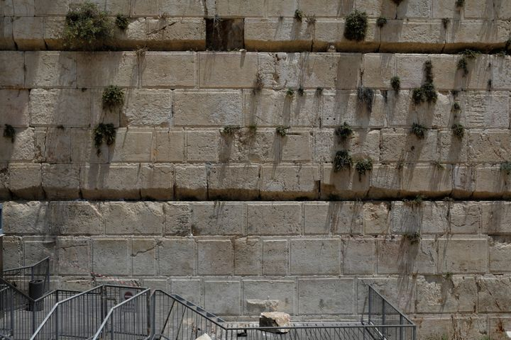 A stone that fell off the Western Wall in Jerusalem can be seen near the wall in Jerusalem's Old City on Monday.