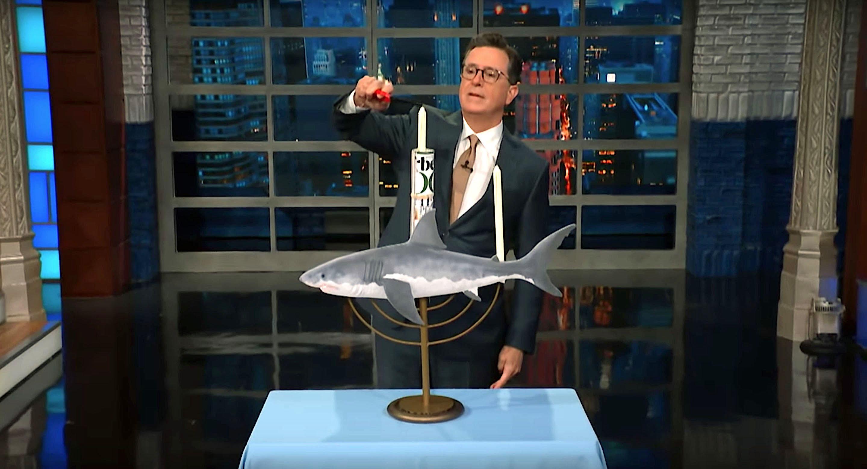 Late Show host Stephen Colbert celebrates Shark Week