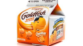 Miami, Florida, USA - May 27, 2015: 2 Ozs Carton Container of Pepperidge Fram Goldfish baked snack cheddar flavored crackers on white background. Pepperidge Farm is a commercial bakery in the U.S. founded in 1937 by Margaret Rudkin, who named the brand after her family's property in Fairfield, Connecticut, which in turn was named for the pepperidge tree, Nyssa sylvatica. It is based in Norwalk, Connecticut. In 1961, it was acquired by Campbell Soup Company.