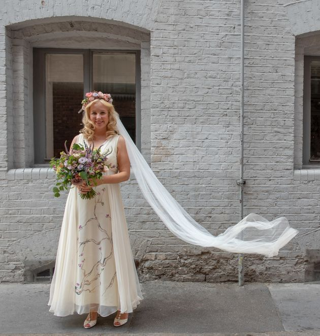 Caroline Millin-Brawnwore a 1970s second-hand white dress with hand painted silk flowers to her