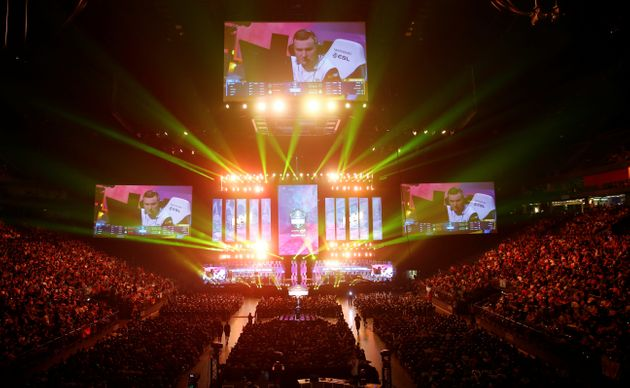 Fans watch the final of the ESL One Cologne Counter-Strike tournament at the Lanxess Arena in Cologne,