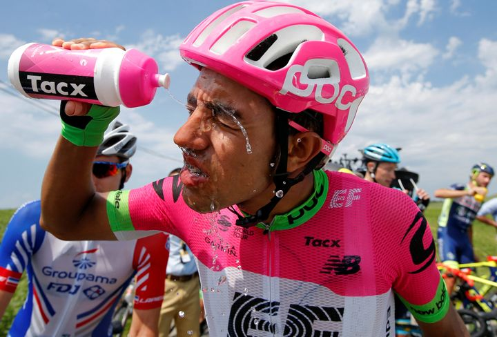 Daniel Felipe Martinez of Colombia, who's riding for team EF Education First - Drapac p/b Cannondale, cleans his eyes af