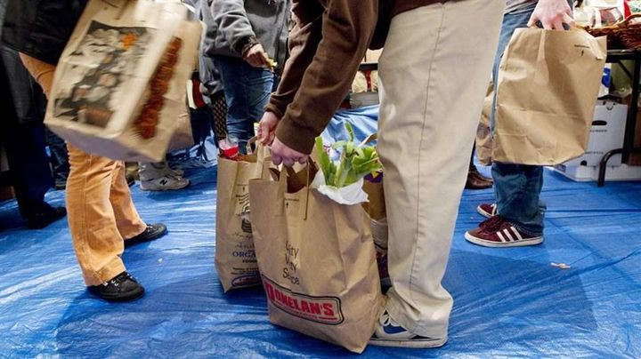 Volunteers gather bags of groceries for people seeking assistance at a food pantry in Concord, Massachusetts. A new study fin