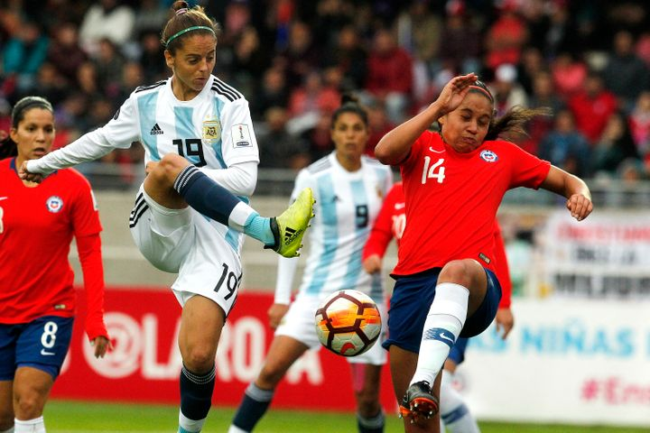 Argentina's Mariana Larroquette (front left) and Chile's Fernanda Pinilla (right) during a Women's Copa America match in Serena, Chile on April 22. Chile has qualified for the 2019 Women World Cup in France.