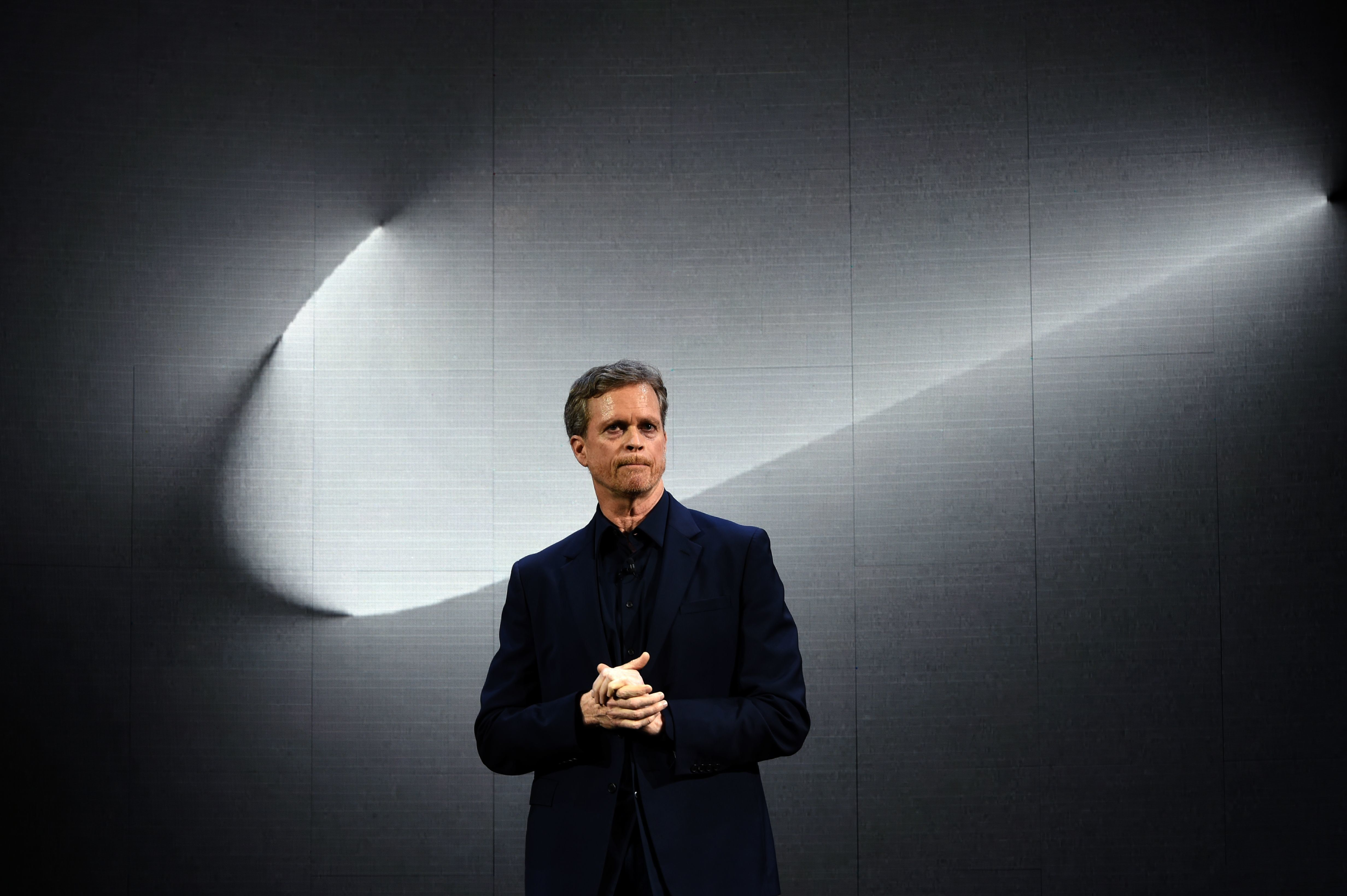 Nike president and CEO Mark Parker reveals their latest innovative sports products during an event in New York on March 16, 2016.  Nike revealed a series of products highlighted by the groundbreaking adaptive lacing platform, as well as a pioneering technology that separates mud from cleats and transformations in the celebrated innovations of Nike Air and Nike Flyknit.  / AFP PHOTO / Jewel SAMAD        (Photo credit should read JEWEL SAMAD/AFP/Getty Images)