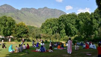 SRINAGAR, J&K, INDIA - 2018/06/05: People enjoy under the shades of chinar trees at a famous Mughal Garden on a hot summer day in Srinagar, Indian administered Kashmir. The heat wave continued in Srinagar city with mercury soaring above normal temperature and no immediate respite predicted by the Weather Department. The maximum temperature in the city was recorded at 34.4 degree Celsius, 8.1 notches above normal on Monday. (Photo by Saqib Majeed/SOPA Images/LightRocket via Getty Images)
