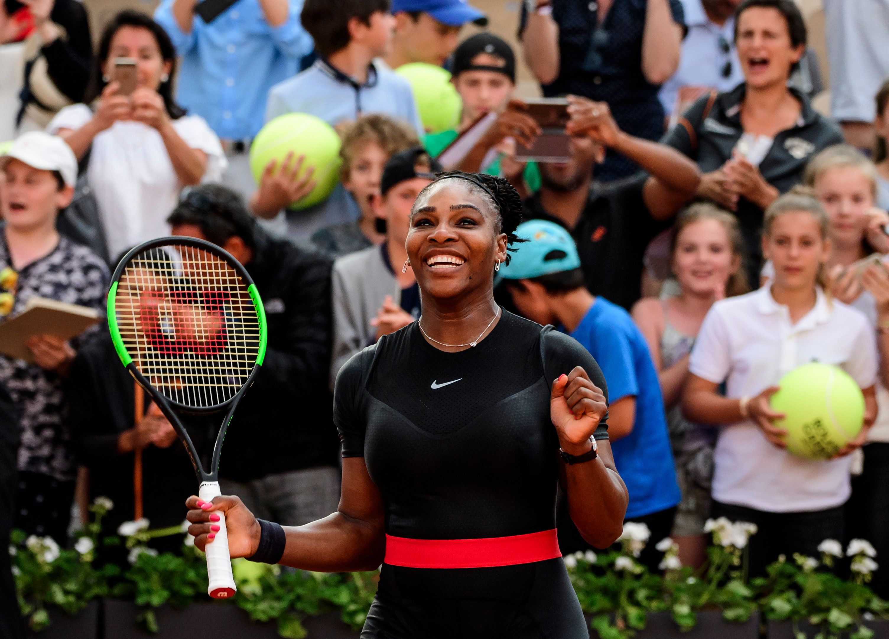 PARIS, FRANCE - JUNE 02: Serena Williams of the United States celebrates after beating Julia Goerges of Germany 6-3 6-4 in the third round of the women's singles during the French Open at Roland Garros on June 2, 2018 in Paris, France. (Photo by Mike Frey/Getty Images)
