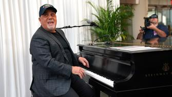 Musician Billy Joel poses at the piano after a press conference at Madison Square Garden July 18, 2018 to celebrate his achievement of 100 lifetime performances at Madison Square Garden in New York. - Joels 100th lifetime performance comes 40 years after his first Madison Square Garden  performance, on December 14, 1978. (Photo by TIMOTHY A. CLARY / AFP)        (Photo credit should read TIMOTHY A. CLARY/AFP/Getty Images)