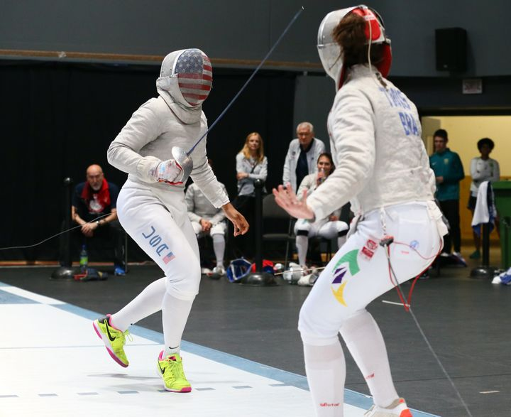 Ibtihaj Muhammad (left) fences Karina Trois of Brazil during the Pan-American Fencing Championships in Montreal on June 17, 2