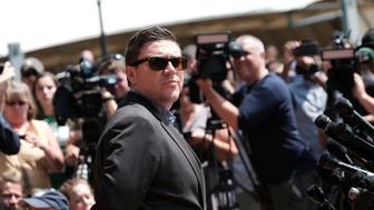 Unite The Right rally organizer Jason Kessler attempts to speak at a press conference in front of Charlottesville City Hall in Charlottesville, Virginia,  August 13, 2017.  REUTERS/Justin Ide