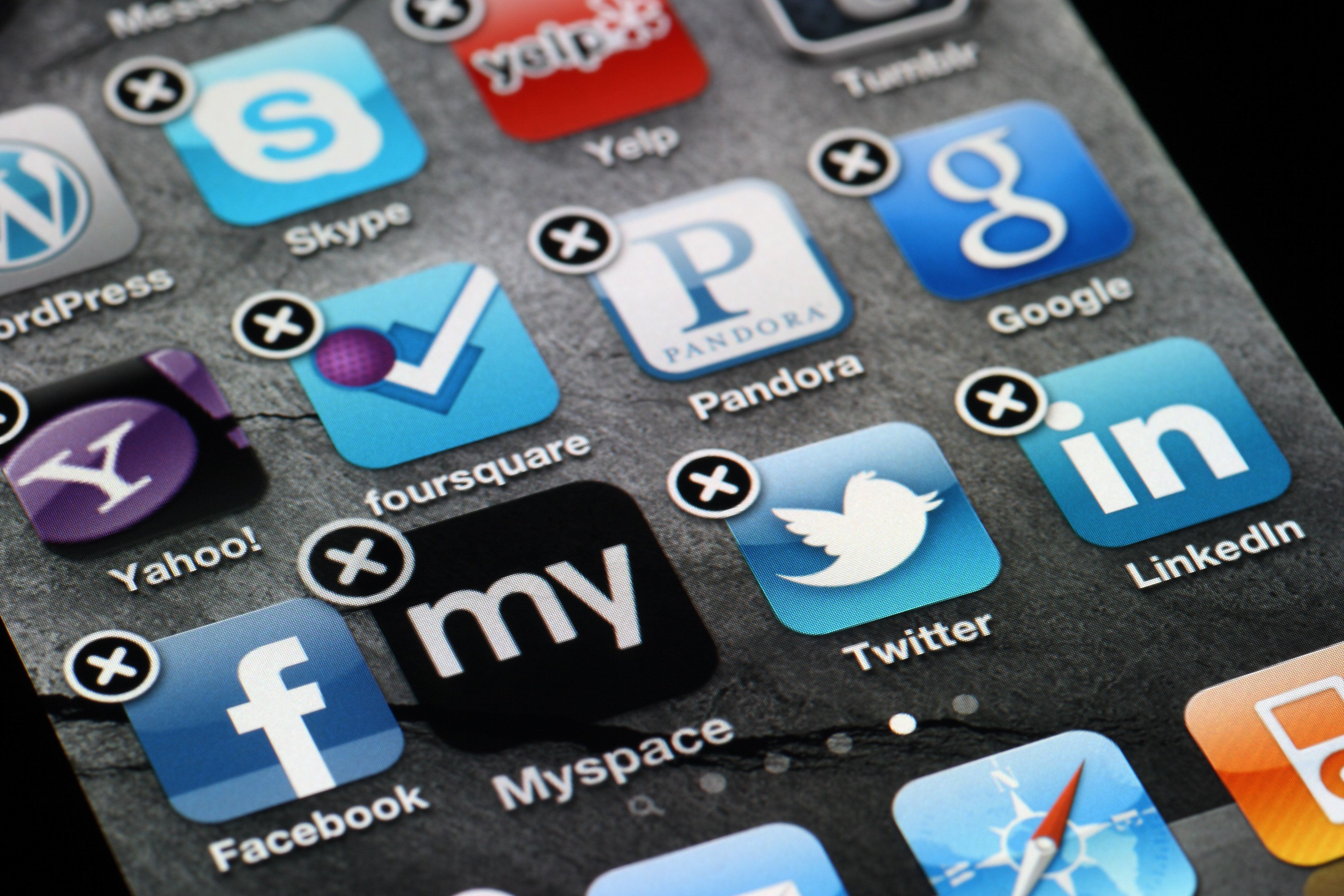 'San Francisco, California, USA - April 9, 2012:  The Myspace app being deleted from an Apple iPhone 4, showing various other social media apps, including Facebook, Twitter, LinkedIn, Foursquare, and Pandora.'