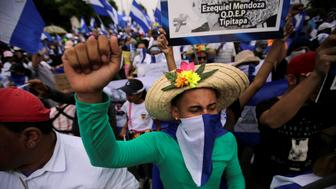 A demonstrator gestures during a march to demand the ouster of Nicaragua's President Daniel Ortega in Managua, Nicaragua, July 23, 2018. REUTERS/Jorge Cabrera