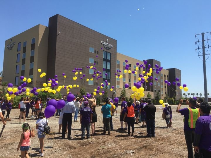 Yellow and purple balloons are released in celebration of a tentative dealthat promises better wages for Disney employe
