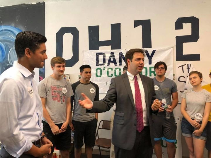 Democrat Danny O'Connor, center, speaks to campaign volunteers as Aftab Pureval, a Democratic candidate in Ohio's 1st, looks