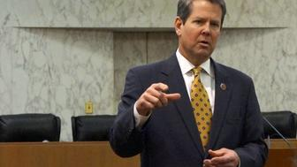 """FILE PHOTO:  Georgia Secretary of State Brian Kemp speaks with visitors to the state capitol about the """"SEC primary"""" involving a group of southern states voting next month in Atlanta, Georgia, U.S., February 24, 2016.  REUTERS/Letitia Stein/File Photo"""