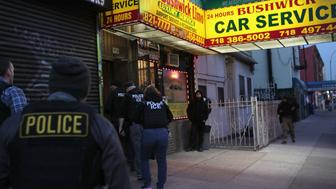 NEW YORK, NY - APRIL 11:  U.S. Immigration and Customs Enforcement (ICE), officers stage a raid to arrest an undocumented immigrant on April 11, 2018 in New York City. New York is considered a 'sanctuary city' for undocumented immigrants, and ICE receives little or no cooperation from local law enforcement.  ICE said that officers arrested 225 people for violation of immigration laws during the 6-day operation, the largest in New York City in recent years. (Photo by John Moore/Getty Images)