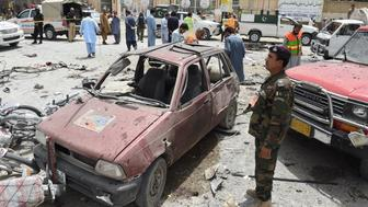 Pakistani security personnel gather at the site of a suicide attack near a polling station in Quetta on July 25, 2018. - At least 30 people were killed and dozens more wounded in a suicide attack on a polling station in the southwestern Pakistani city of Quetta, officials said, as millions voted in a nationwide election on July 25. (Photo by BANARAS KHAN / AFP)        (Photo credit should read BANARAS KHAN/AFP/Getty Images)