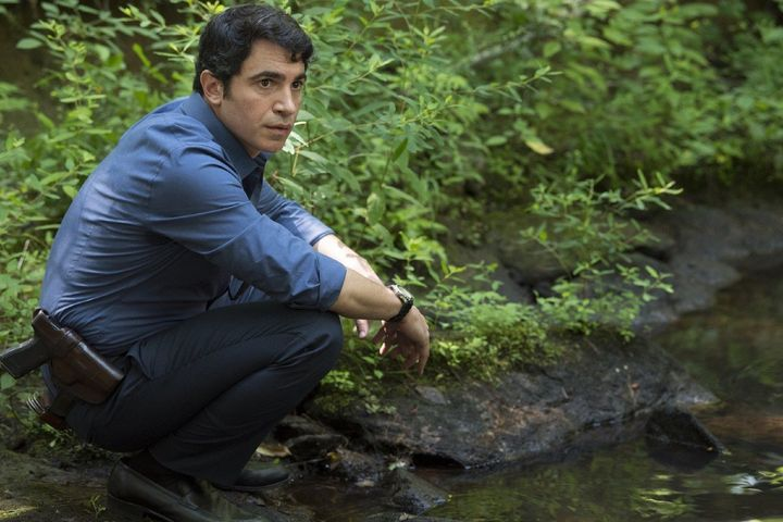 """Chris Messina, playing a detective, looks for clues about a missing girl's whereabouts in """"Sharp Objects."""""""