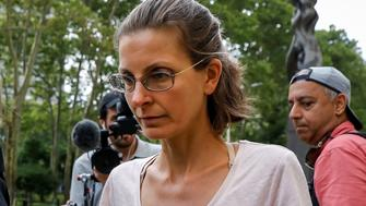 Clare Bronfman, an heiress of the Seagram's liquor empire, exits following her arraignment on charges of racketeering and conspiracy in relation to the Albany-based organization Nxivm at the United States Federal Courthouse in Brooklyn at New York, U.S., June 24, 2018. REUTERS/Brendan McDermid