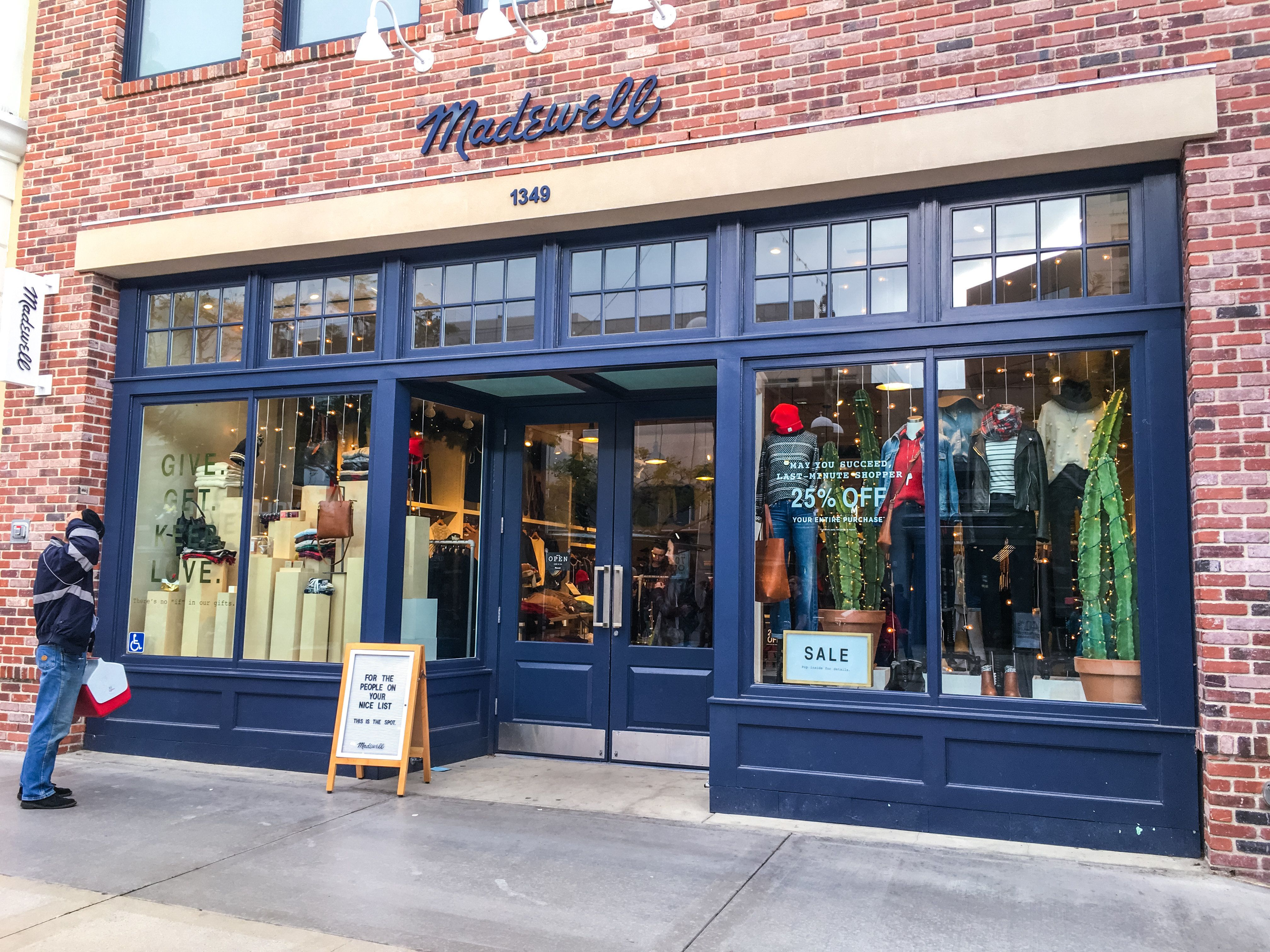 Santa Monica, USA  - December 22, 2015: Xmas sales at Madewell store, Santa Monica, USA. Man looking at window display. Third street promenade.
